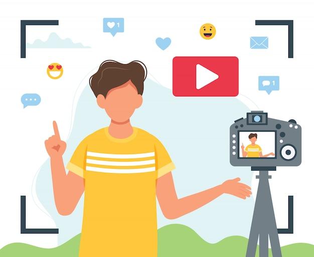Video blogger video mit kamera aufnehmen.