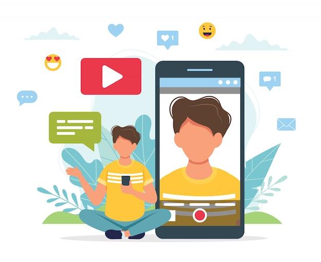 Video blogger videoaufnahme mit smartphone.