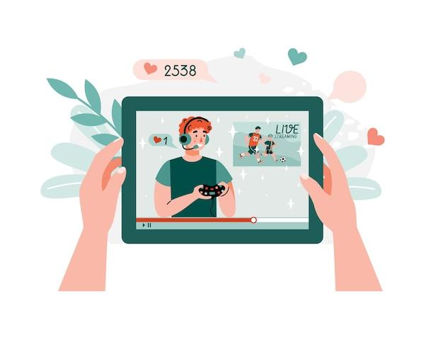 Video-tutorial auf dem tablet. junger mann, der videospiele auf video-hosting-plattform für abonnenten, flacher karikaturillustrationsweißhintergrund spielt