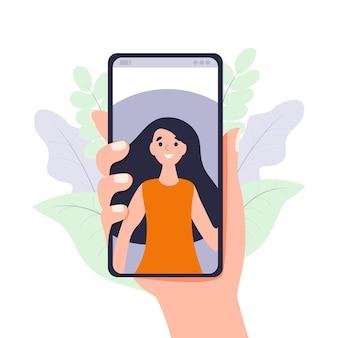 Videoanruf über smartphone hand hält mobiltelefon mit eingehender videokonferenz-technologie