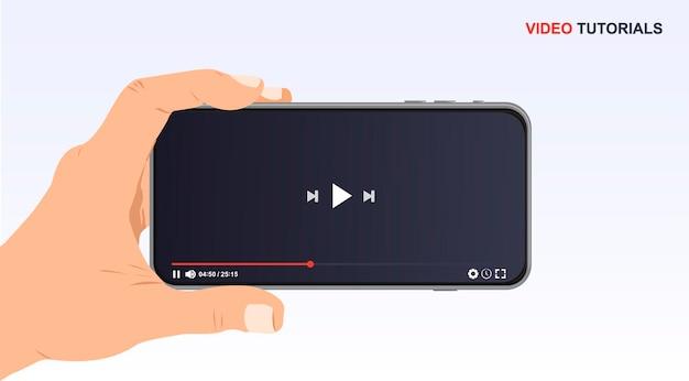 Videoplayer-designvorlage für web- und mobile apps in der hand video-online-modell abspielen