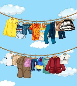 Viele kleider hängen an einer linie auf blauem himmelhintergrund