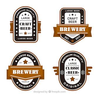 Vier bieraufkleber im vintage-stil