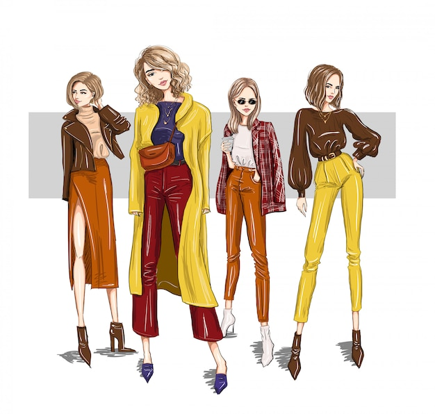 Vier helle mädchenmodels in trendigen outfits