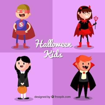 Vier niedliche halloween-kinder