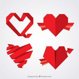 Vier origami rote herzen
