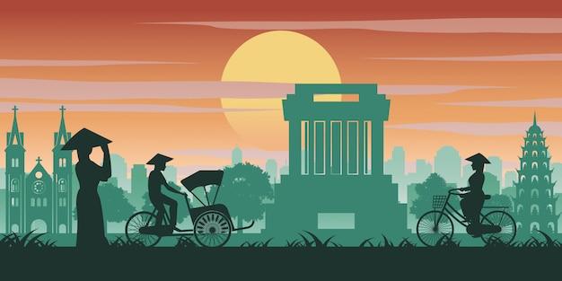 Vietnamesische frau und mann fahren fahrrad vorbei wahrzeichen