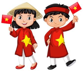 Vietnamesisches Mädchen und Junge im roten Kostüm