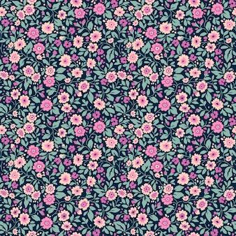 Vintage blumenmuster in den kleinen lila blüten nahtloser vektor textur blauer hintergrund