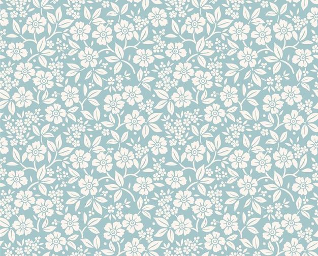 Vintage blumenmuster in kleinen weißen blumen nahtloser druck für modedruck blauer hintergrund