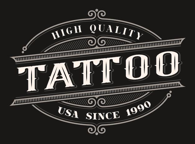 Vintage farbige beschriftung für das tattoo-studio auf dem dunklen hintergrund. alle elemente befinden sich in separaten gruppen