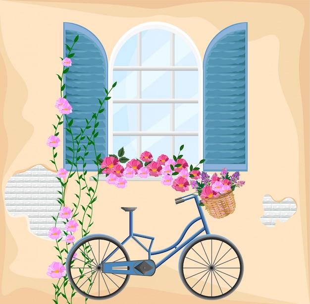 Vintage fenster mit blumen. fahrrad und blumenstrauß