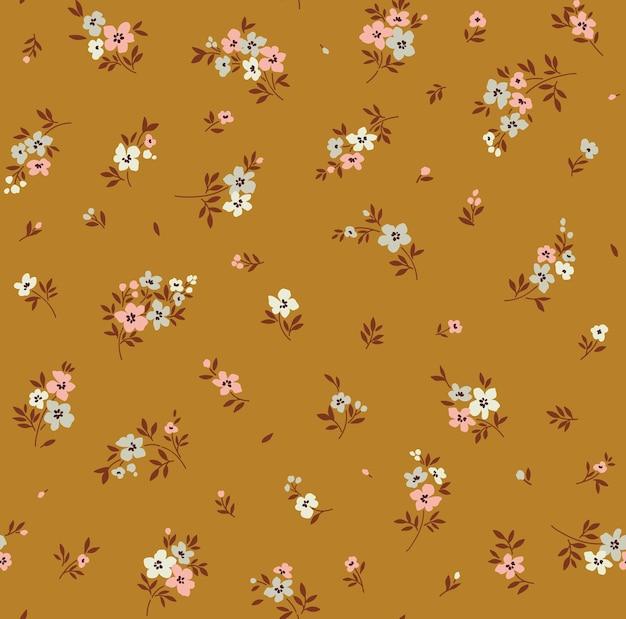 Vintage floral background nahtloses vektormuster mit kleinen blumen auf einem mustar-hintergrund