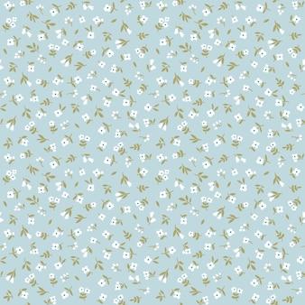 Vintage floral background nahtloses vektormuster mit kleinen weißen blumen auf blauem hintergrund