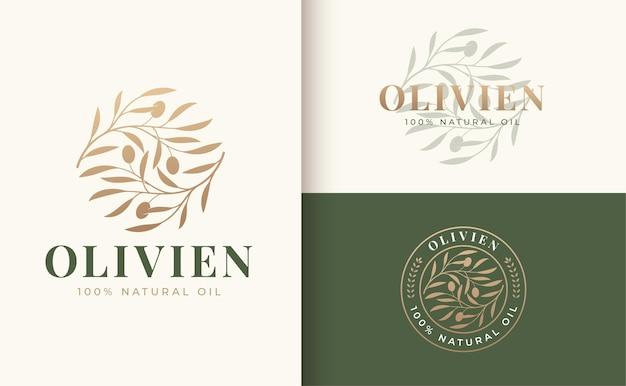 Vintage olivenzweig logo und abzeichen design Premium Vektoren