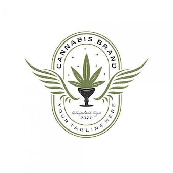 Vintage retro cannabis und flügel logo premium