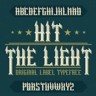 Vintage schrift namens hit the light. gute schriftart für jedes vintage-logo.