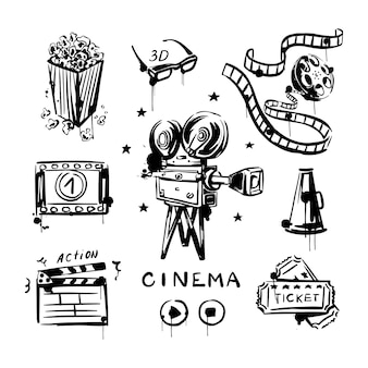Vintage-set mit baumwollspulen-kamera-lautsprecher und popcorn-tickets isoliert auf weißem hintergrund