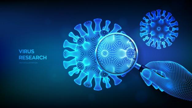 Virusforschungskonzept mit lupe in drahtgitterhand und abstrakten neuartigen coronavirus-bakterien covid-19. lupe und viruszelle hautnah.