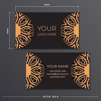 Visitenkartenvorbereitung mit griechischer verzierung. schwarzes visitenkartendesign mit vintage-mustern.