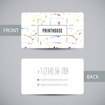 Visitenkartenvorlage für den druck mit tintenspritzelementen. karte mit cmyk-farbflecken und -flecken