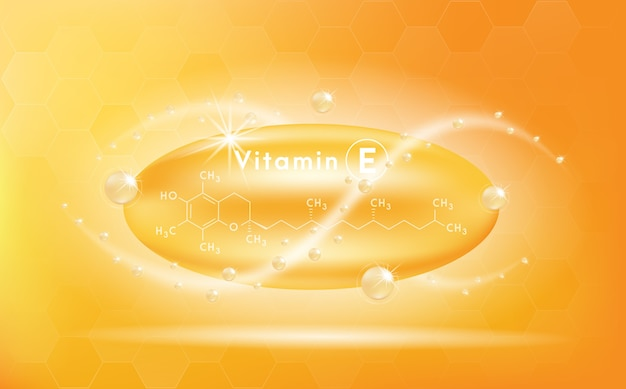 Vitamin e und struktur. medizin kapsel, goldene substanz.
