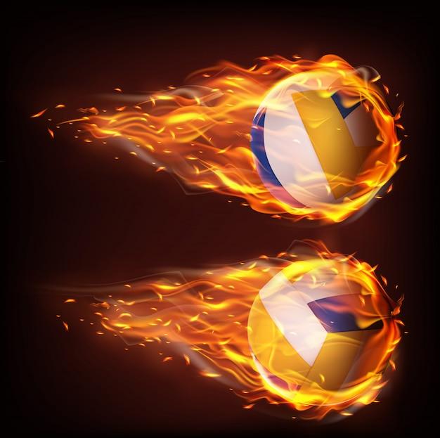 Volleyballbälle, die in das feuer fliegen und in flamme fallen