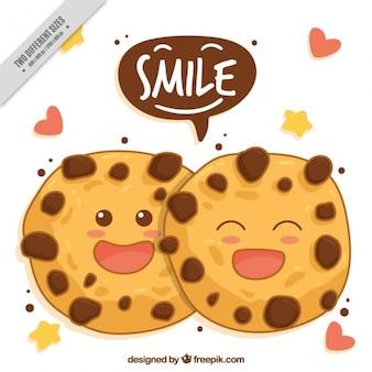 Von hand gezeichnet hintergrund der lächelnden cookies