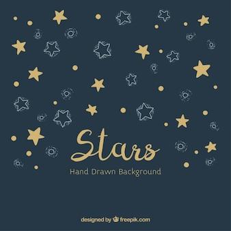 Von hand gezeichnet hintergrund mit goldenen und weißen sternen