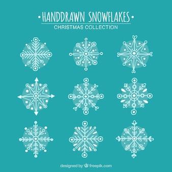 Von hand gezeichnet schneeflocken mit geometrischen mustern