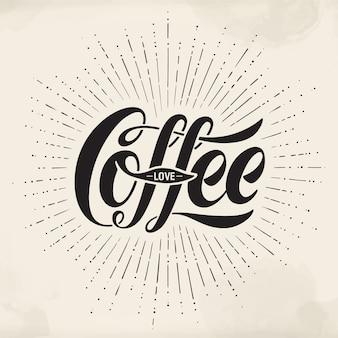Von hand gezeichnete beschriftungsaufschrift kaffee-liebe auf aquarellhintergrund. typografisch und kalligraphisch.