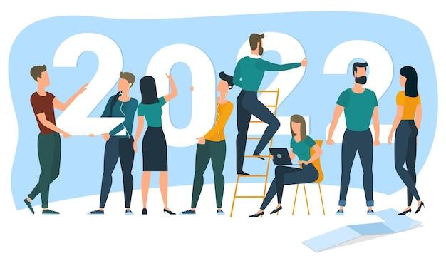 Vorbereitung auf das neue jahr 2022 menschen bauen die zahlen 2022