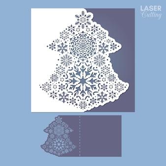 Vorlage für weihnachtskarten, mit aus papier ausgeschnittenem weihnachtsbaum.
