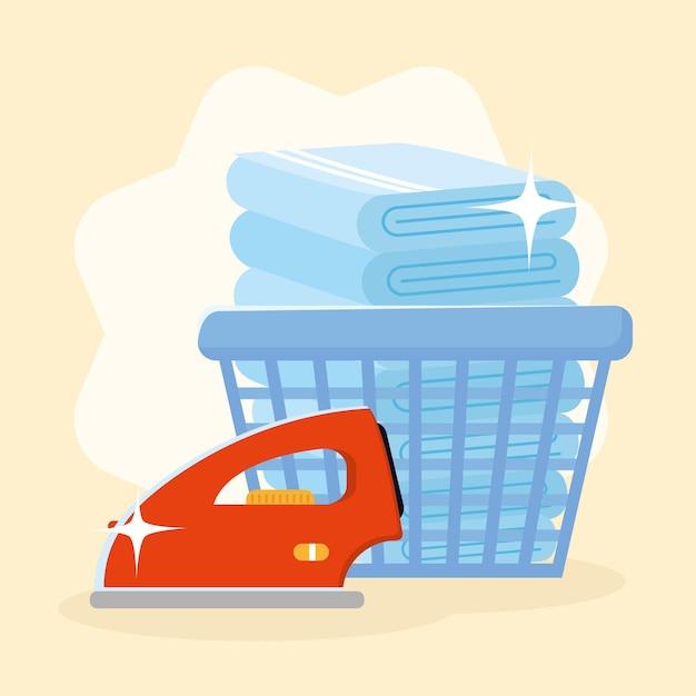 Wäschehandtücher im korb mit bügeleisen auf gelbem hintergrund
