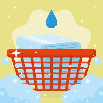 Wäschehandtücher im korb mit tropfen auf gelbem hintergrund