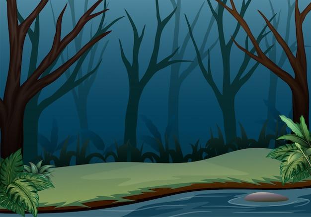 Waldlandschaft auf nachtszene mit trockenen bäumen