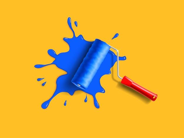 Walzenpinsel mit rotem griff und blauem farbspritzer an der orangefarbenen wand