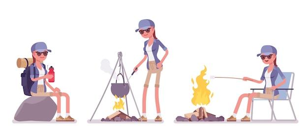 Wanderfrau, die am lagerfeuer ruht
