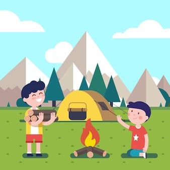 Wandernde kinder am lagerfeuer