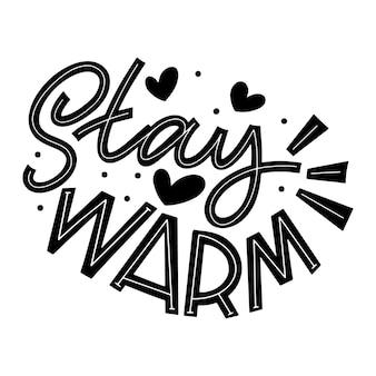 Warm bleiben. handgeschriebene winterbeschriftung. designelemente für winter- und neujahrskarten. typografische gestaltung. vektor-illustration.
