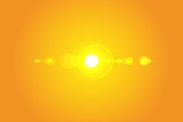 Warme sonne auf gelbem grund. sommer. blendung. sonnenstrahlen.