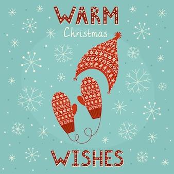 Warme weihnachtswunschkarte mit kuscheligen handschuhen und mütze.