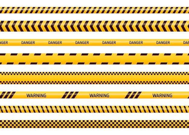 Warn- und gefahrenbänder in gelber und schwarzer farbe. polizeiaufmerksamkeitslinie oder im bau befindliches band, warnzeichensammlung lokalisiert auf weißem hintergrund.