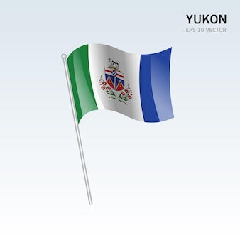 Waving flag of yukon provinzen von kanada auf grauem hintergrund isoliert