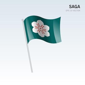 Wehende flagge der präfekturen saga von japan isoliert auf grauem hintergrund