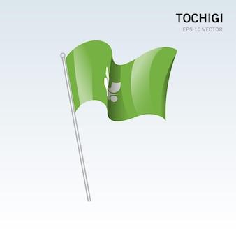 Wehende flagge der präfekturen tochigi von japan isoliert auf grauem hintergrund