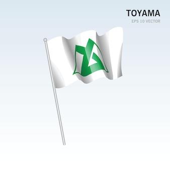 Wehende flagge der präfekturen toyama von japan isoliert auf grauem hintergrund