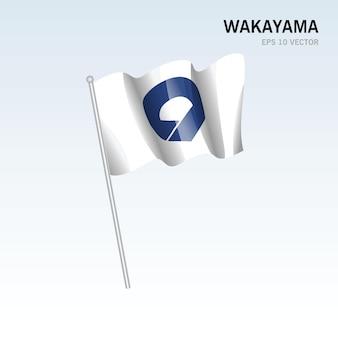 Wehende flagge der präfekturen wakayama von japan isoliert auf grauem hintergrund