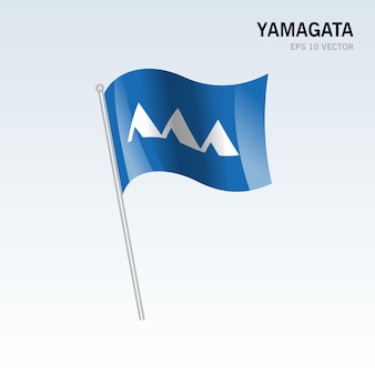 Wehende flagge der präfekturen yamagata von japan isoliert auf grauem hintergrund