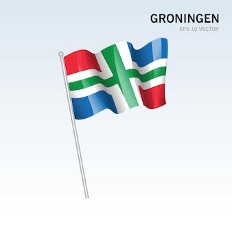 Wehende flagge der provinzen groningen in den niederlanden auf grauem hintergrund isoliert Premium Vektoren